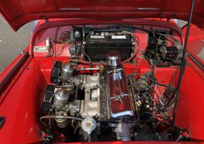 Triumph TR3 rouge cabriolet 00001